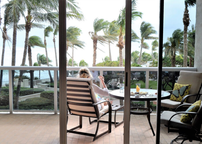 patio overlooking beach at a vacation home.