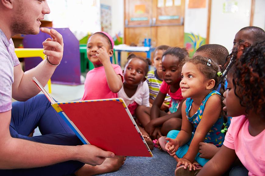 volunteer reading to children.
