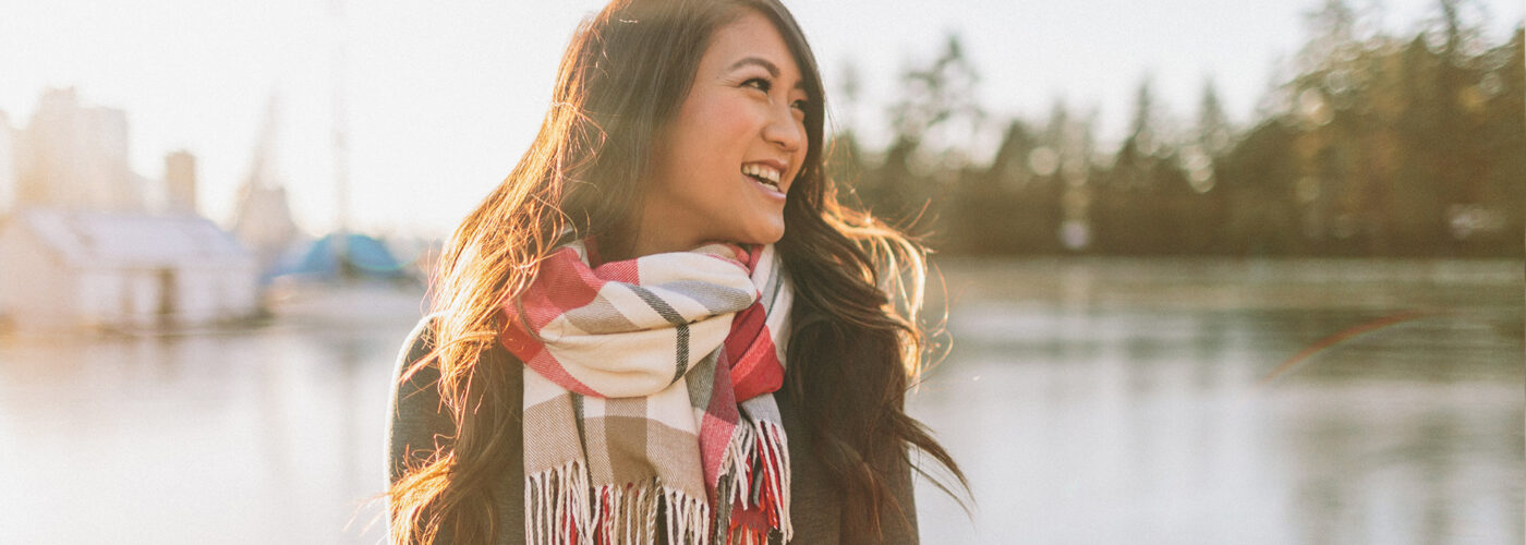 woman wearing scarf lake