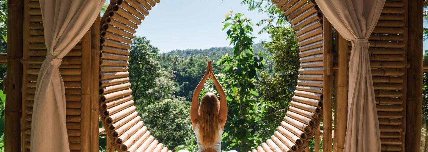 woman-yoga-pose-open-air-resort