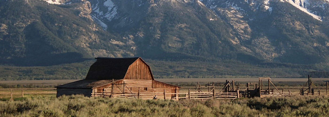 Mormon Row barn and Grand Teton National Park mountains in Jackson Hole, Wyoming.