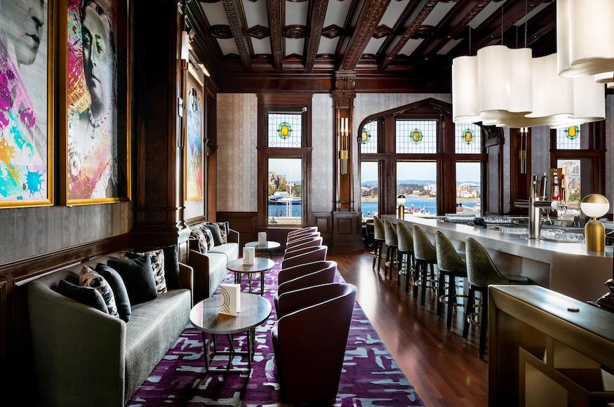 View of the q bar with harbor in background at fairmont empress