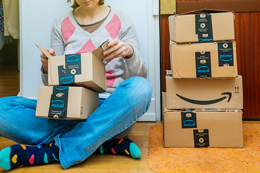 woman opening prime boxes amazon