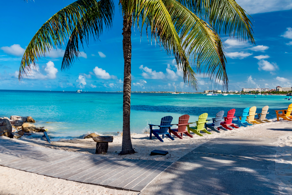 colorful chairs on beach in aruba