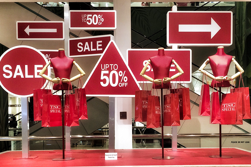 sale signs shopping window mannequins