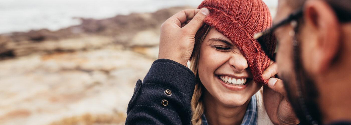 Woman wearing winter hat.