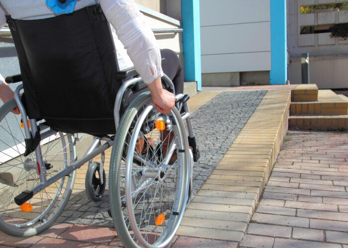 woman in wheelchair using ramp.