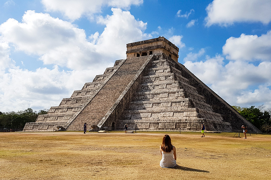 Girl in Front of Pyramide of Chichen Itza Mexico