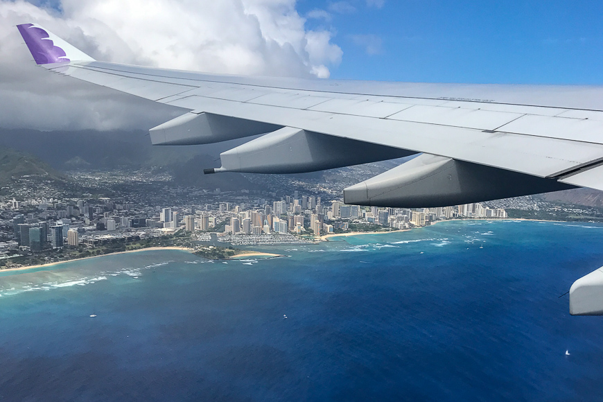 plane flying over city in hawaii