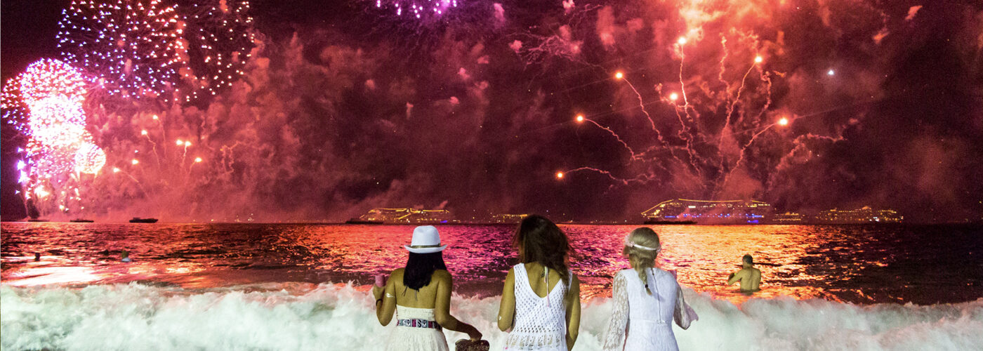 Young ladies looking the New Year's Eve fireworks in Rio de Janeiro, Brazil