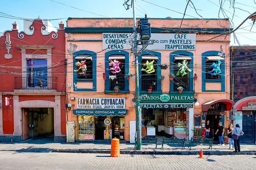 Local businesses at a colorful colonial building in Coyoacan, a historic neighborhhod in Mexico City K