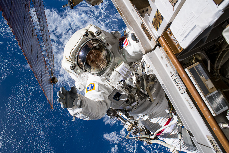 Astronaut does a space walk in as he upgrades cameras on the orbital platform.