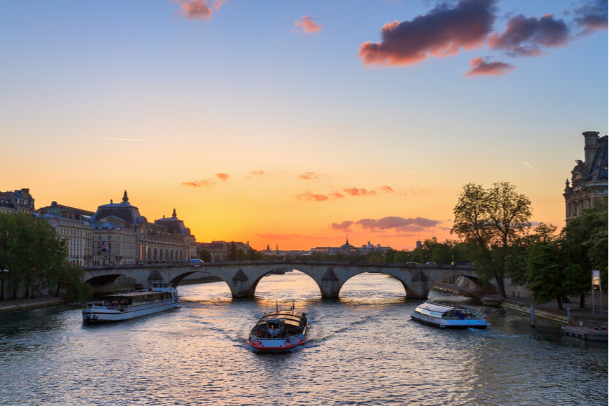 river cruise seine paris france at sunset.