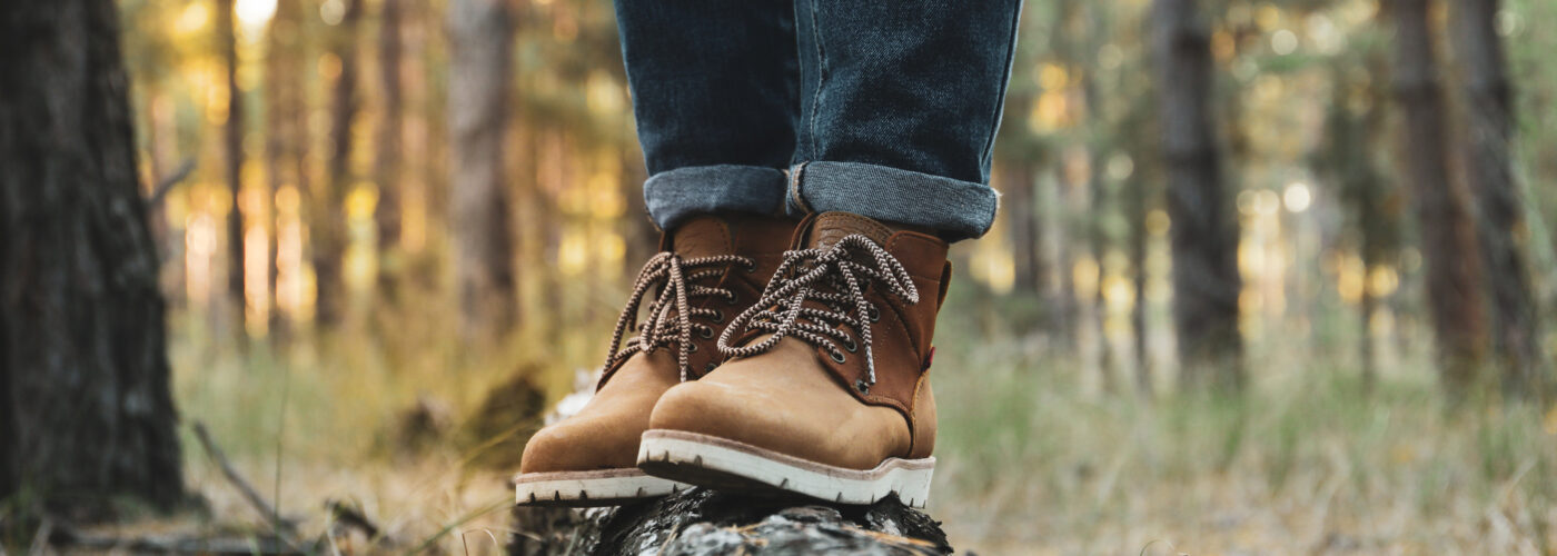 man wearing jeans and stylish hiking boot