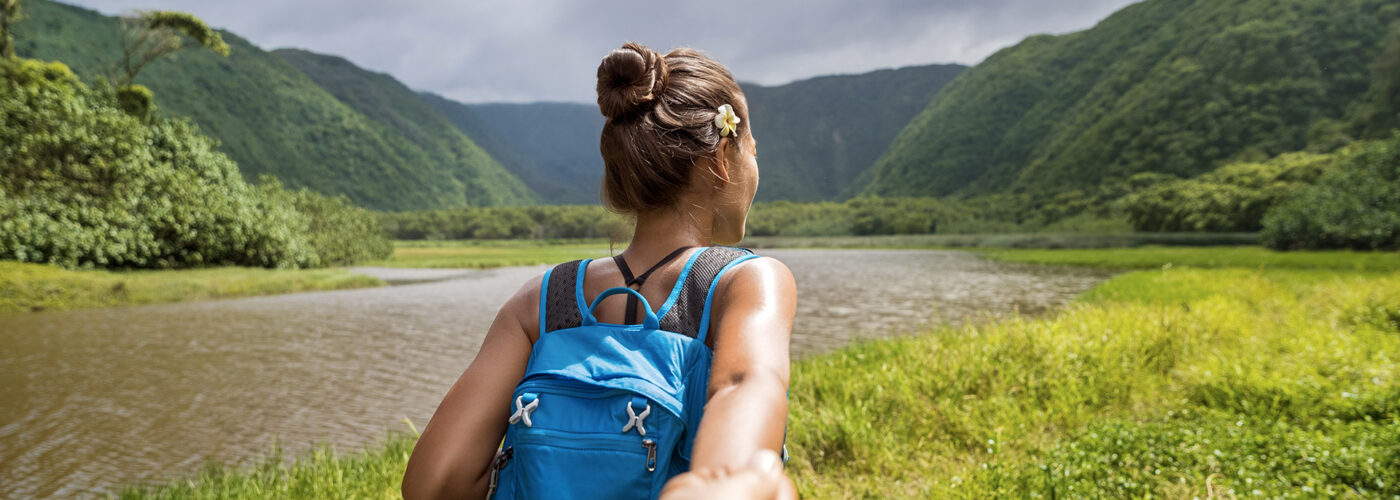 woman hiking tropical forest hawaii