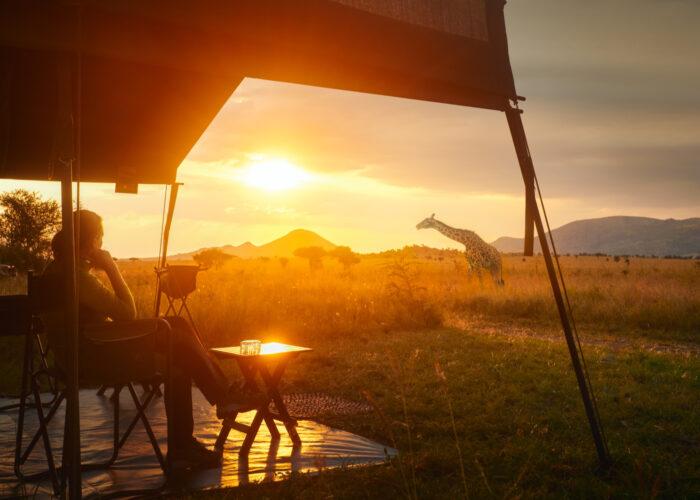 woman on safari serengeti national park tanzania.