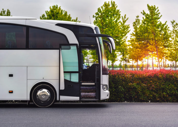 Luxury bus waiting for passengers in parking lot