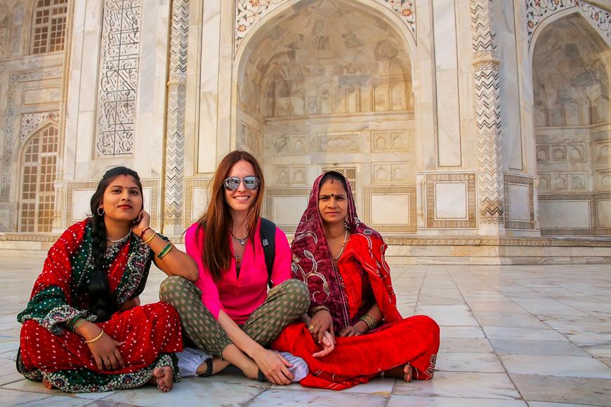 Unidentified women sit outside Taj Mahal in India
