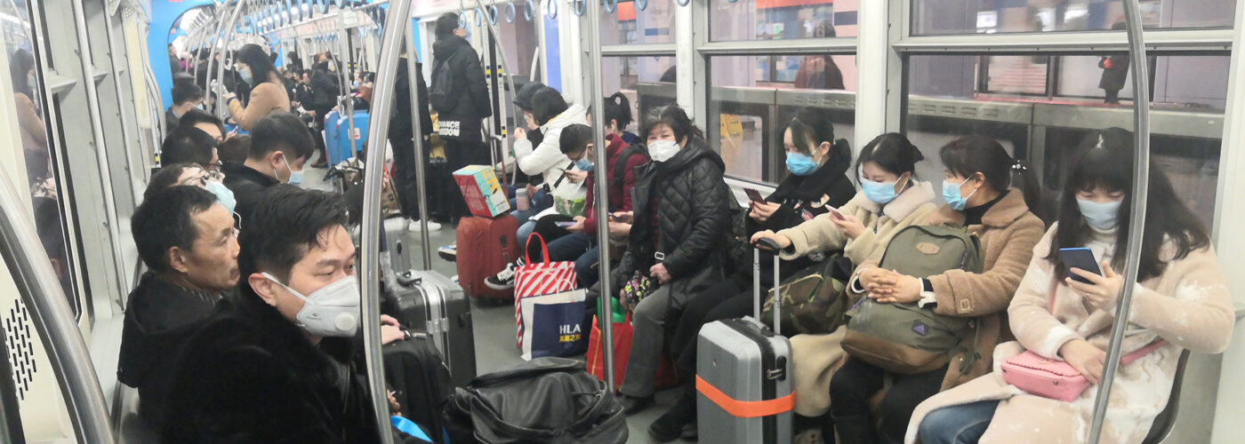 people wearing masks on china metro train.