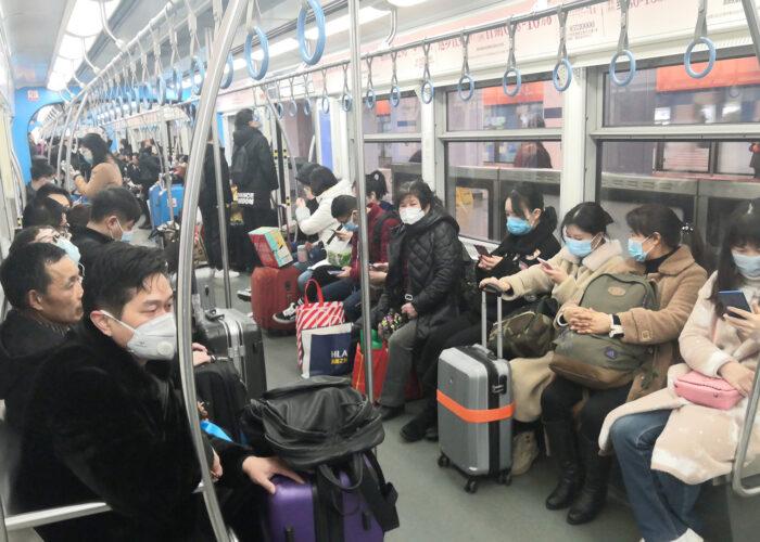 people wearing masks on china metro train.