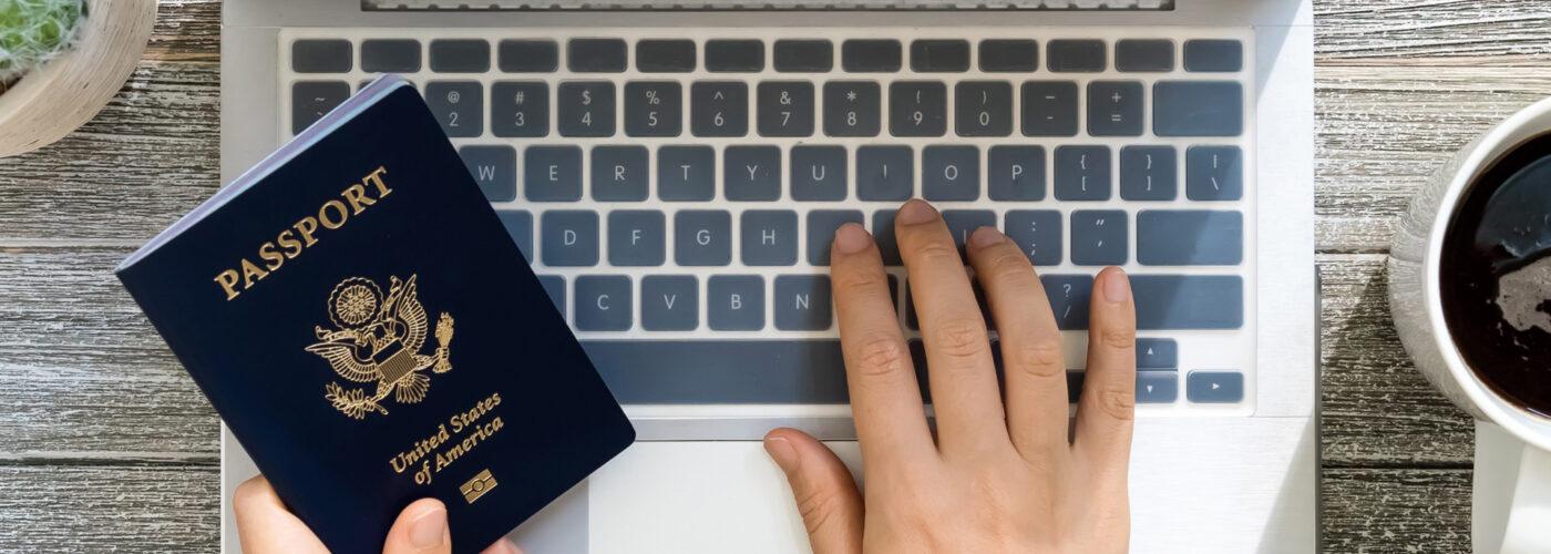 person using laptop to renew passport