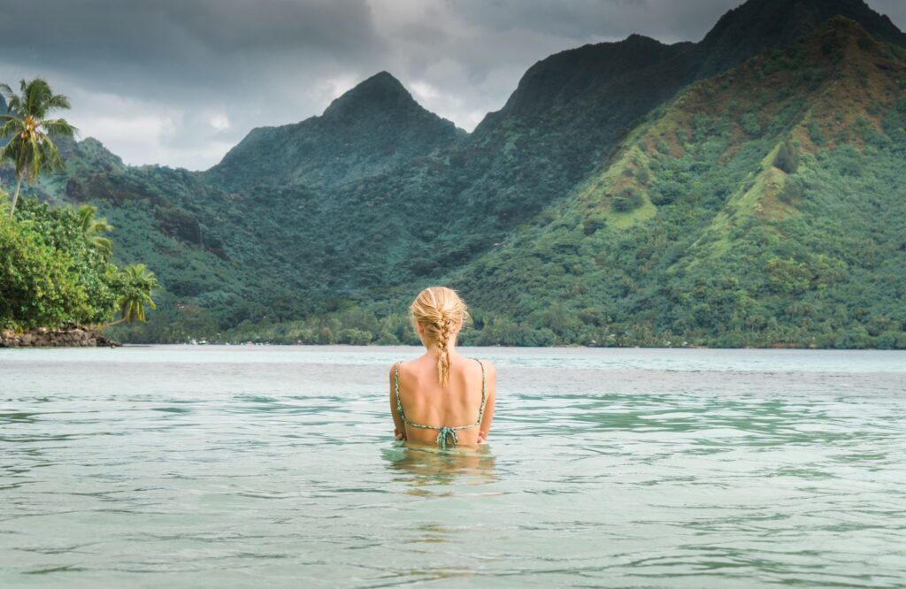 woman in ocean in tahiti