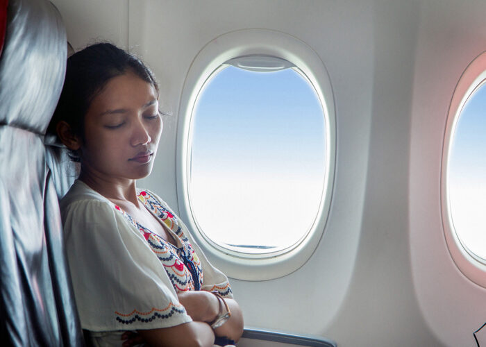 woman sleeping on plane.