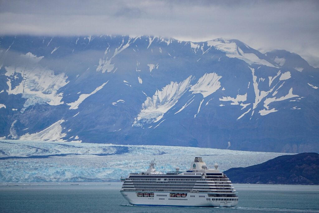 alaska iceberg with cruise ship