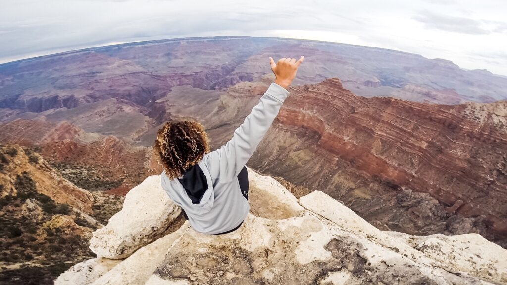 person overlooking grand canyon