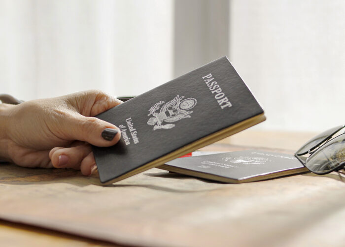 hand holds a United States passport