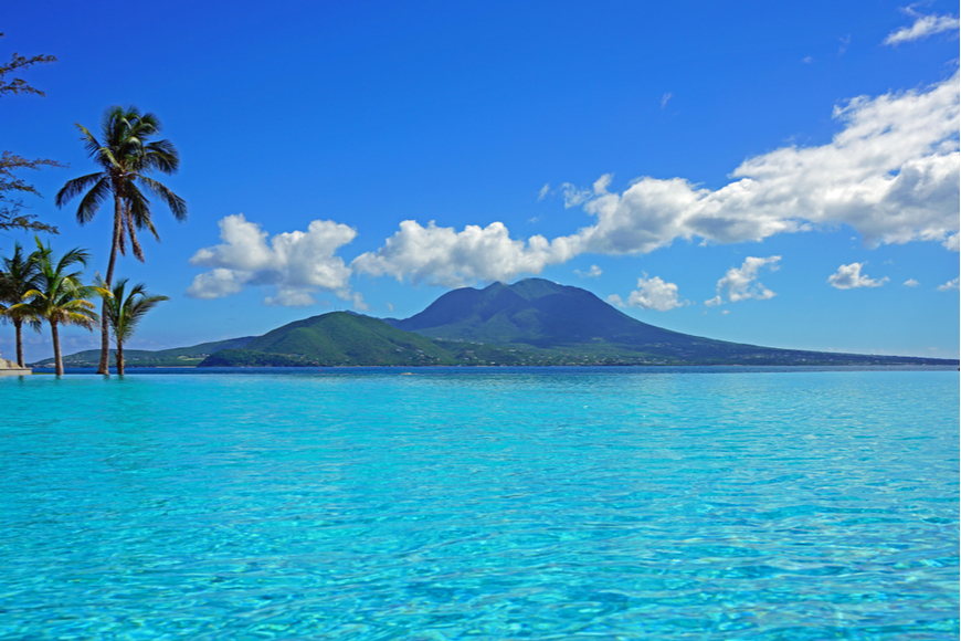 nevis peak from swimming pool st. kitts, caribbean.