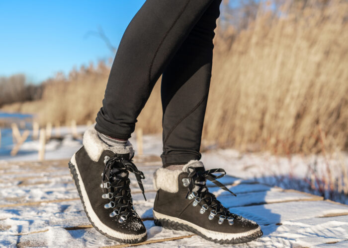 woman in tights and sneakers in winter.
