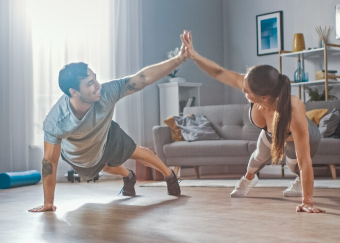 Couple working out in home gym