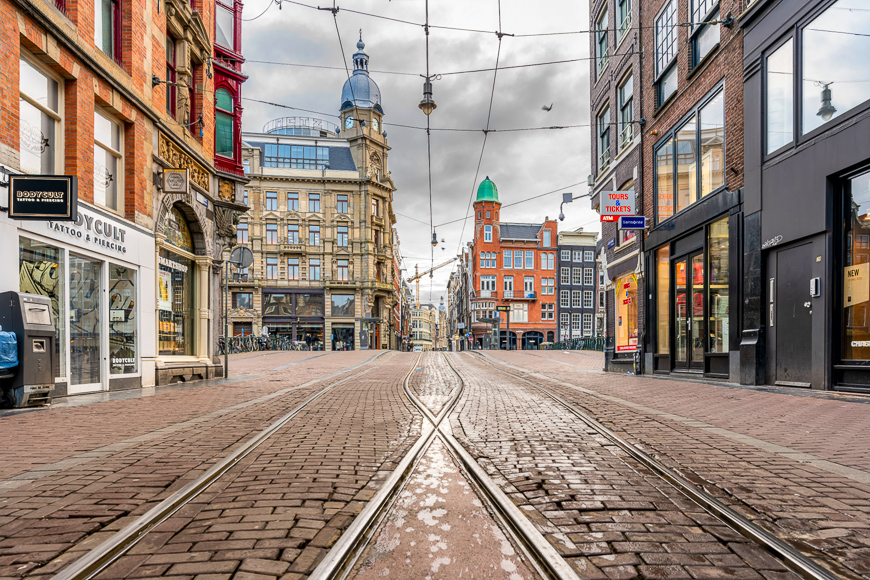 typically busy streets of Amsterdam are shown nearly empty as the Coronavirus pandemic