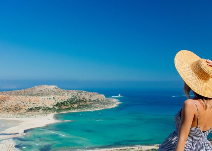girl in hat on balos greece.