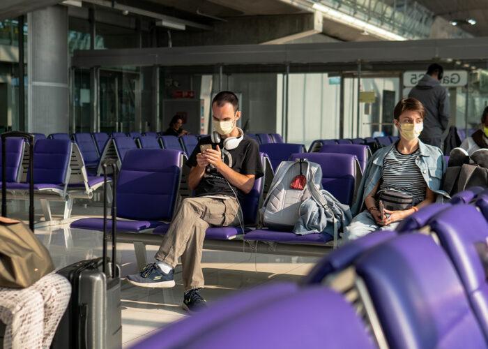 coronavirus pandemic COVID-19 in airports. Quarantine and protective measures to stop the spread of the virus around the world.