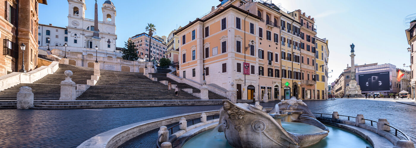 Two foreign tourists take pictures on the Spanish Steps, Rome, Italy. Popular tourist sites have been deserted following the nnationwide coronavirus pandemic lockdown.