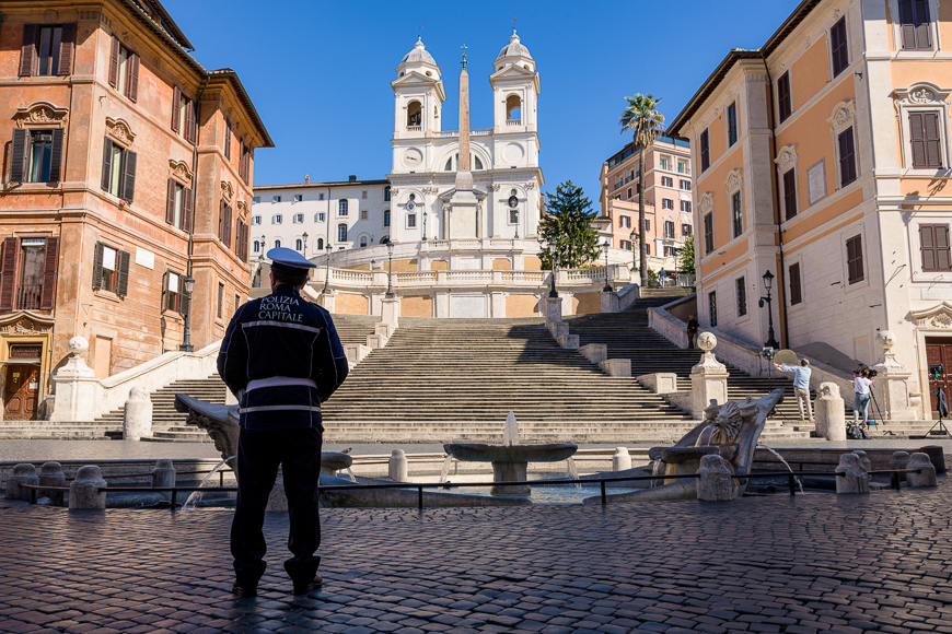 A Police stands alone in front of the Spanish Steps in Rome, Italy