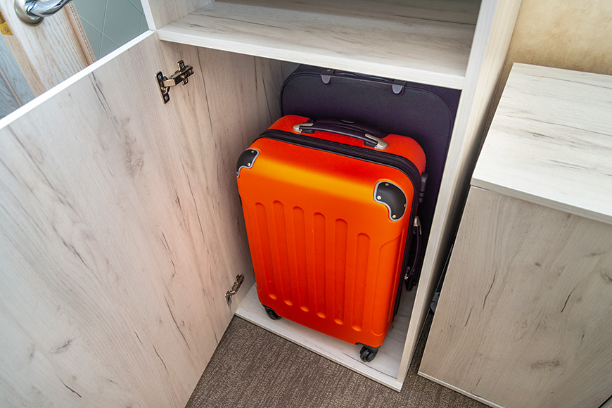 suitcase storage in closet