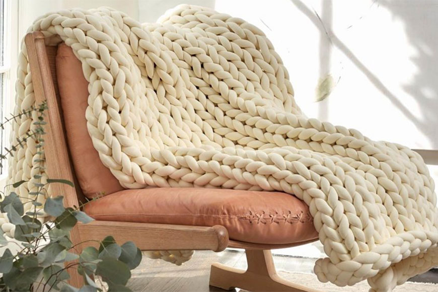 yaasa weighted blanket draped across a chair.
