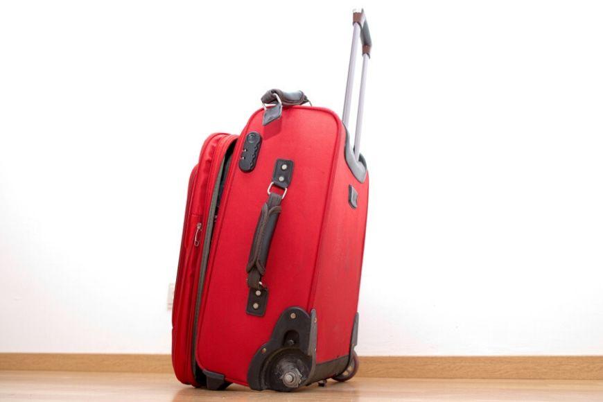 broken wheel on suitcase.
