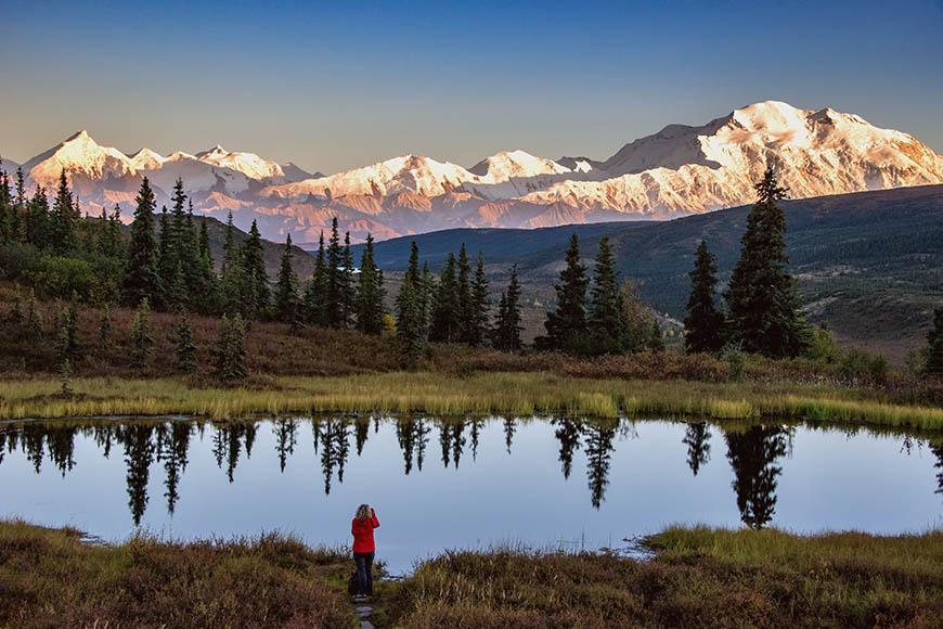 denali national park pond and hiker.