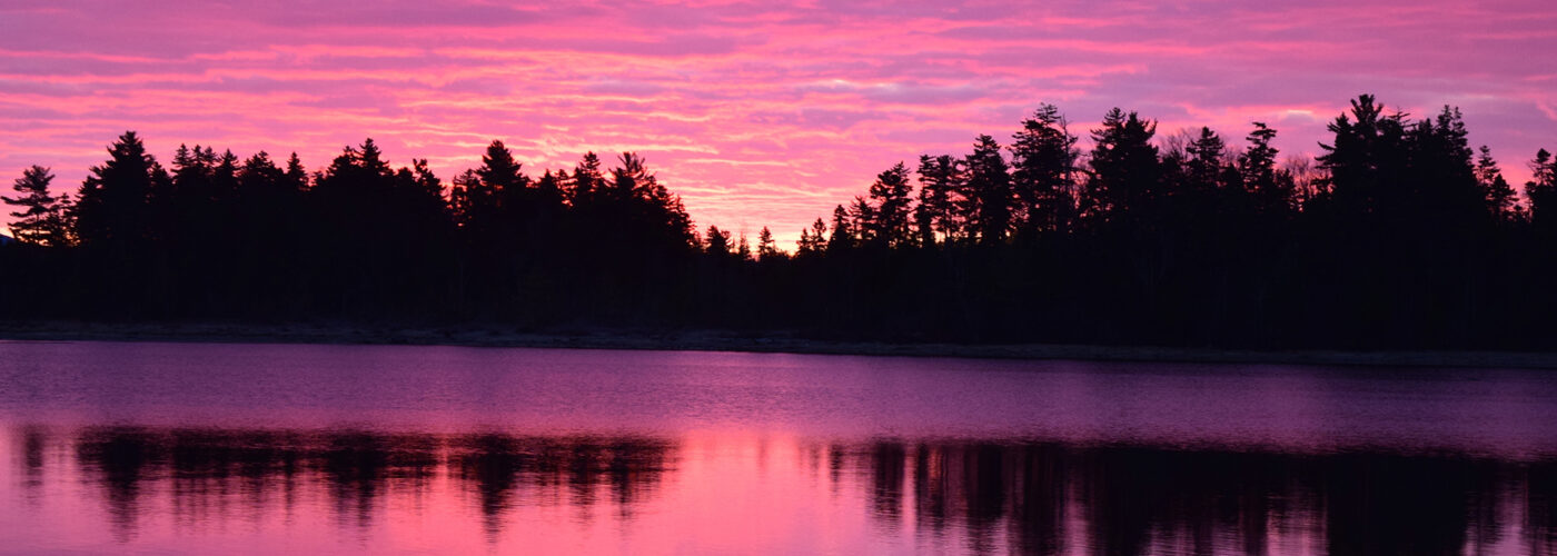 sunrise over moosehead lake maine.