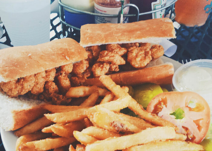 new orleans po-boy sandwich and fries.
