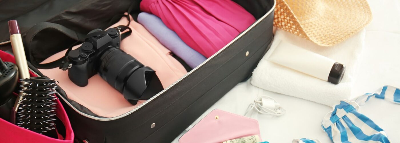 open suitcase packing for travel.