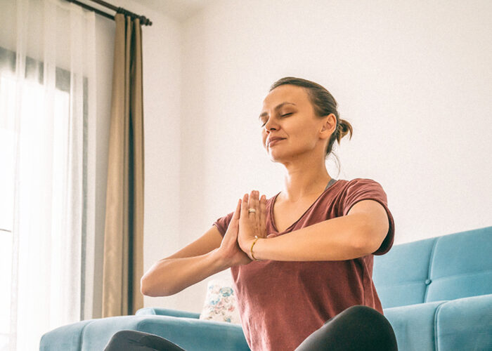 woman stretching meditating or yoga at home