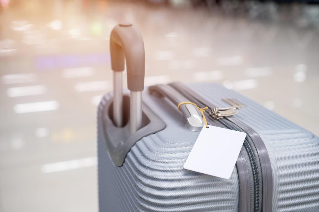 Luggage tag on grey suitcase