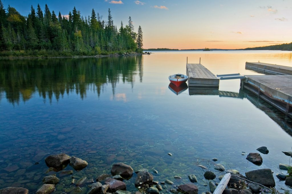 A small boat moored at a dock in Isle Royale National Park, Michigan
