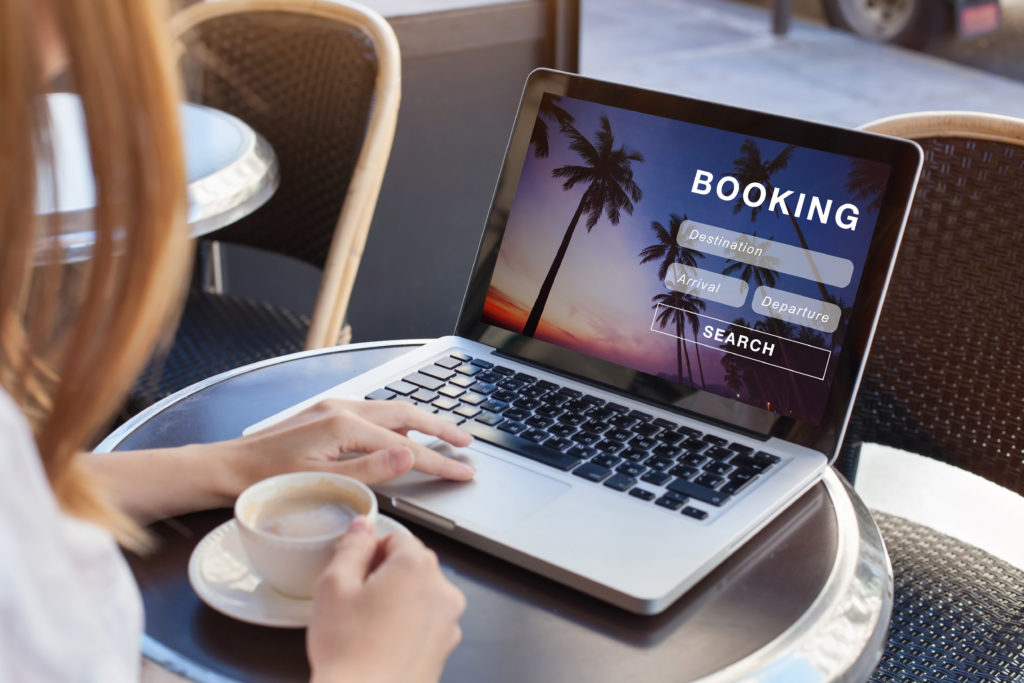 Woman drinking coffee and booking a flight