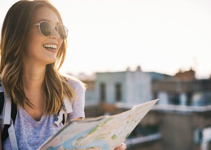 woman traveler looking at map